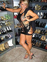 MILF in stripper heels shows her sexy feet