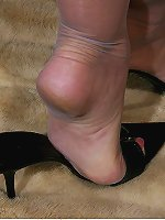 Aroused MILF in pantyhose showing her feet