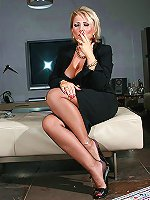 Posh mature lady smoking and showing her legs