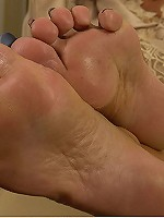 Awesome mature whore showing off her swollen tits and soft sexy feet on cam