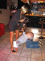 Gorgeous mature bitch punishes sissy dude with cane on his ass