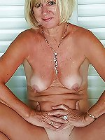 Gorgeous mature mama posing undressed on the street