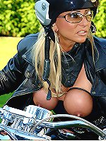 Adorable blonde MILF with big roped tits posing and masturbating on the bike